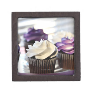 Close-up of cupcakes with selective focus on premium gift boxes