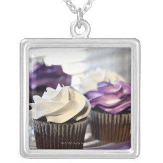 Close-up of cupcakes with selective focus on silver plated necklace