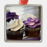 Close-up of cupcakes with selective focus on square metal christmas ornament