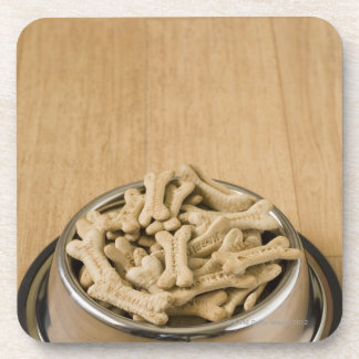 Close-up of dog biscuits in a dog bowl coaster