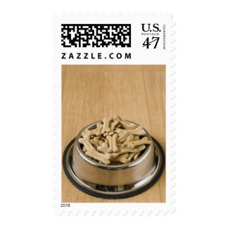 Close-up of dog biscuits in a dog bowl postage