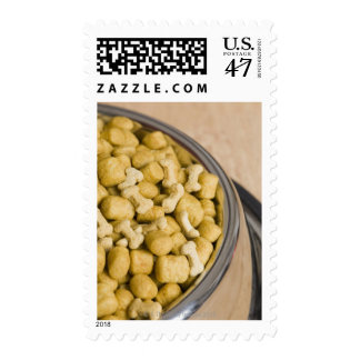 Close-up of dog food in a dog bowl postage
