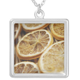 Close-up of dried slices of lemon silver plated necklace