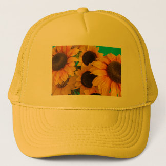 close-up of   flowered sunflowers  on trucker hat