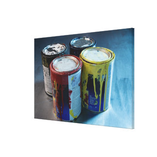 Close-up of four paint cans canvas print