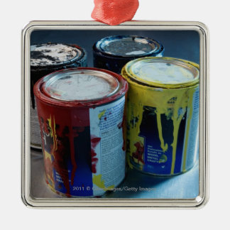 Close-up of four paint cans metal ornament