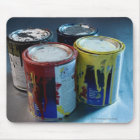 Close-up of four paint cans mouse pad