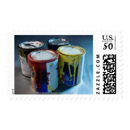 Close-up of four paint cans postage