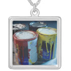 Close-up of four paint cans silver plated necklace