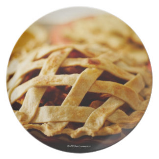 Close-up of fresh pie with lattice pattern crust dinner plate