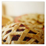 Close-up of fresh pie with lattice pattern crust large square tile