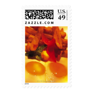 close-up of fried eggs with french fries stamps
