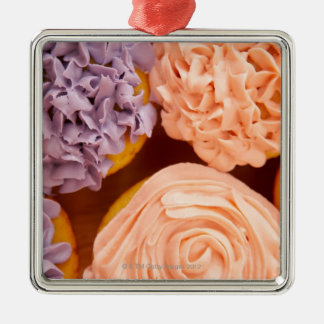 Close-up of frosted cupcakes metal ornament