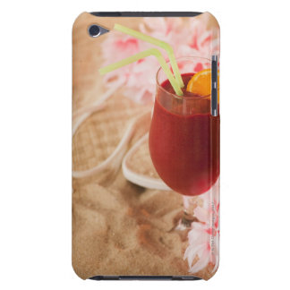 Close up of frozen drink and lei on sand iPod touch case