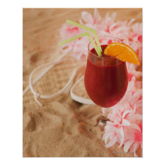 Close up of frozen drink and lei on sand poster