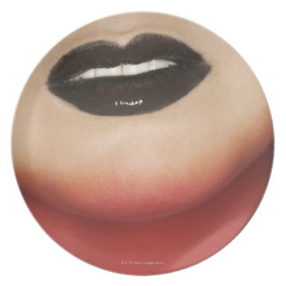 Close-up of glam-rock woman's lips dinner plate