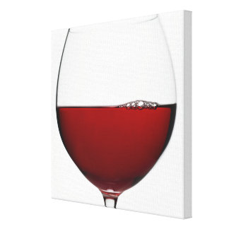 Close up of glass of red wine on white canvas print