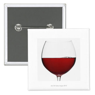 Close up of glass of red wine on white pinback button