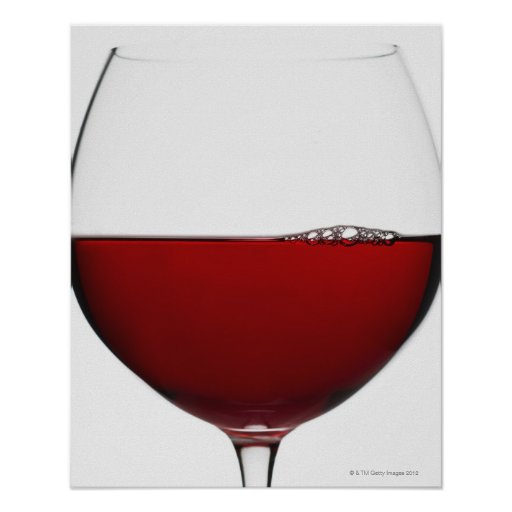 Close up of glass of red wine on white poster