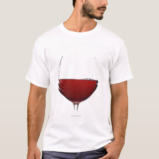 Close up of glass of red wine on white T-Shirt