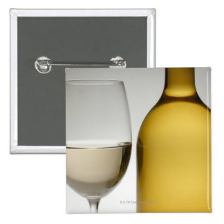 Close up of glass of white wine and wine bottle pinback button