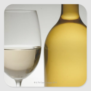 Close up of glass of white wine and wine bottle square sticker