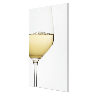 Close up of glass of white wine on white canvas print