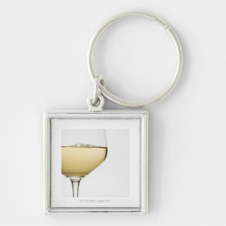 Close up of glass of white wine on white keychain