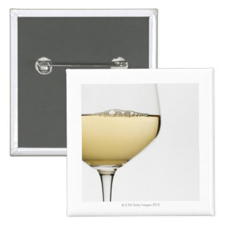 Close up of glass of white wine on white pinback button