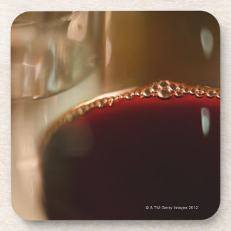 Close-up of glass with red wine beverage coaster