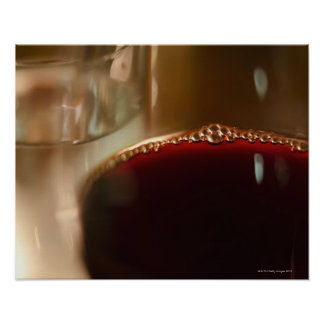 Close-up of glass with red wine poster