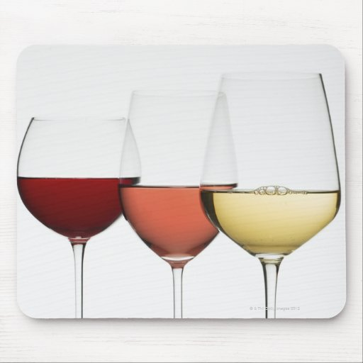 Close up of glasses of different wines mouse pad