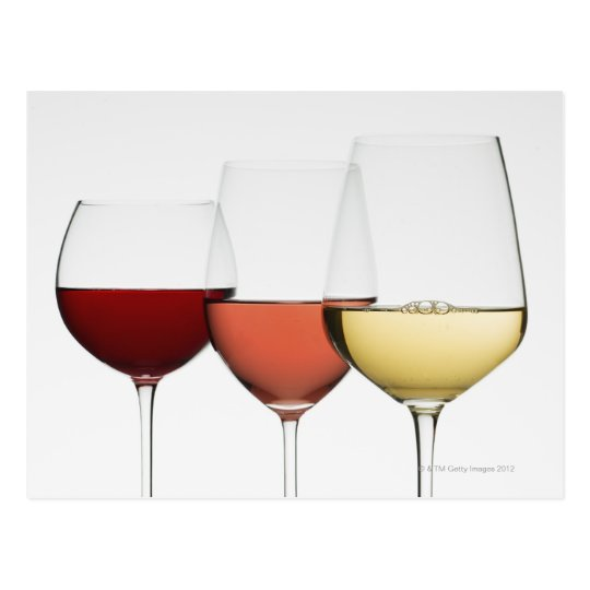 Close up of glasses of different wines postcard