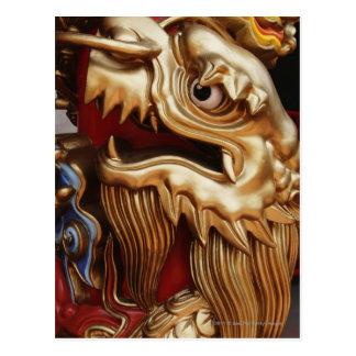 Close up of gold dragon on temple pillar postcard