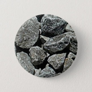 close up of gravel pinback button