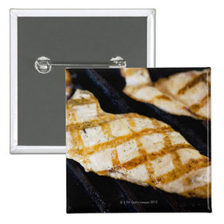Close-up of grilled chicken breasts 2 inch square button