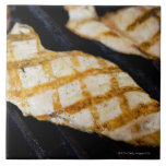 Close-up of grilled chicken breasts large square tile