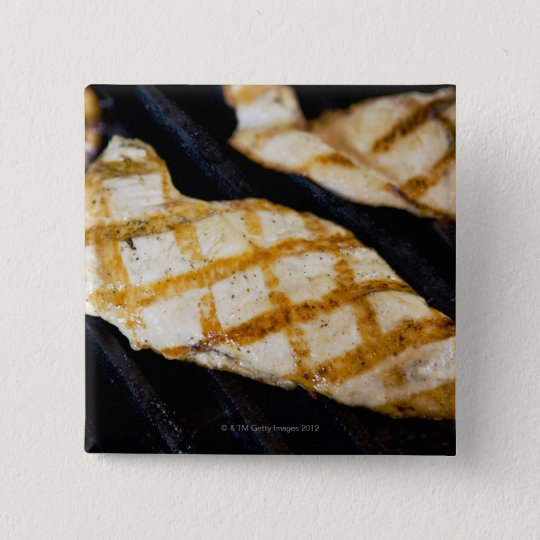 Close-up of grilled chicken breasts pinback button