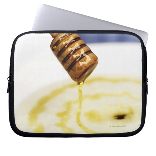 Close-up of honey dribbling on a dessert computer sleeve