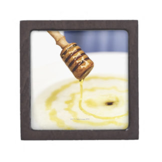 Close-up of honey dribbling on a dessert premium keepsake boxes