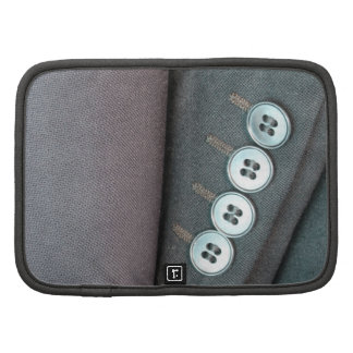 Close up of jacket sleeves with four buttons organizers