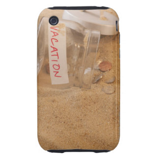 Close up of jar with coins spilled on sand iPhone 3 tough case