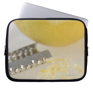 Close-up of lemon and grater computer sleeve