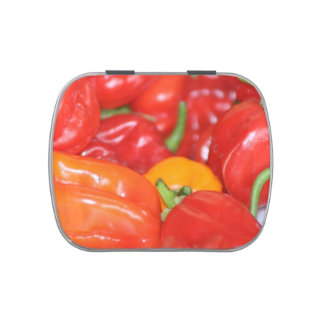 Close up of mainly red hot peppers jelly belly candy tins