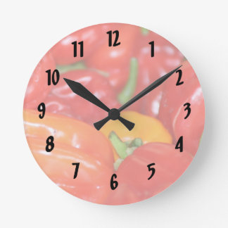 Close up of mainly red hot peppers round clock