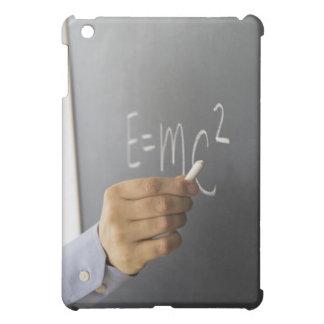 Close-up of man's hand writing theory of iPad mini case