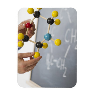 Close-up of man's hands holding molecule model, rectangular photo magnet