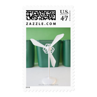 Close up of model of wind turbine and garbage postage stamp