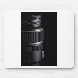 Close up of modern camera lens on black background mouse pad
