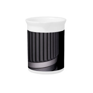 Close up of modern camera lens on black background pitcher